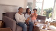 Family Take A Break On Sofa With Pizza On Moving Day video