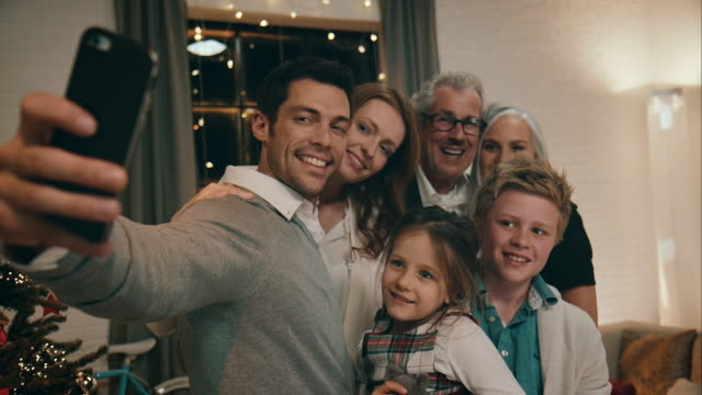 Family taking pictures on christmas eve video