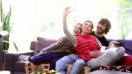 Family taking selfie in the living room video