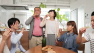 Family toasting with glasses video