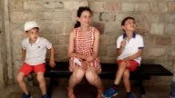 Family together on vacations. Family casually resting on a bench. Children eating ice cream video