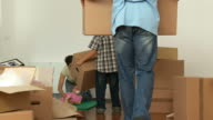 Family Unpacking In New Home video