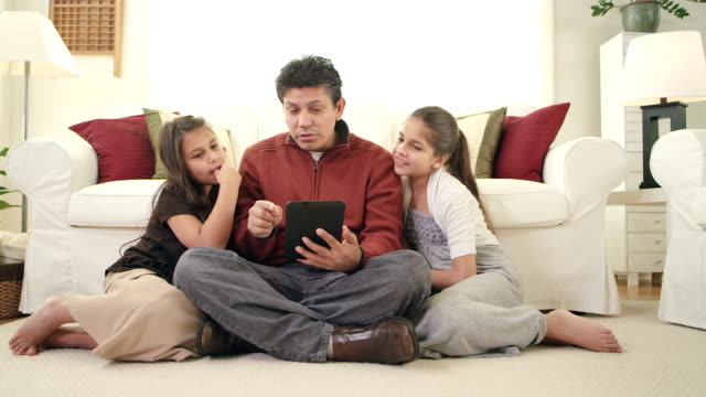 Family uses a tablet together video