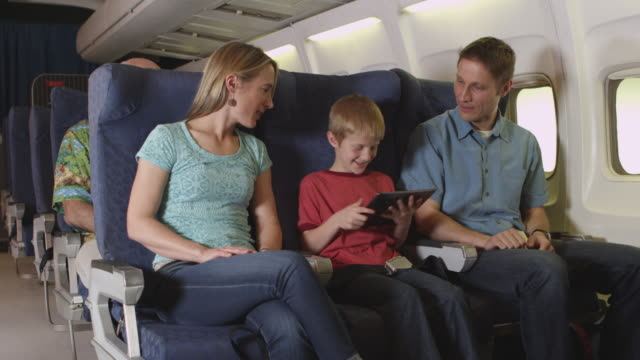 Family using tablet on plane video