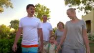 Family walk outdoor on summer resort video