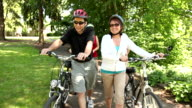 Family walking bicycles together video