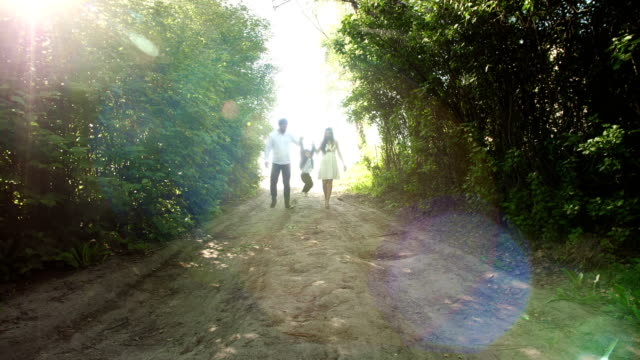 Family walking in the park. video