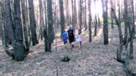 Family walking in the woods video