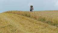 HD: Family Walking in Wheat Field video
