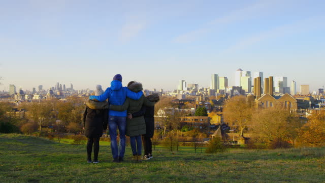 WS Family walking on a hill above the city video
