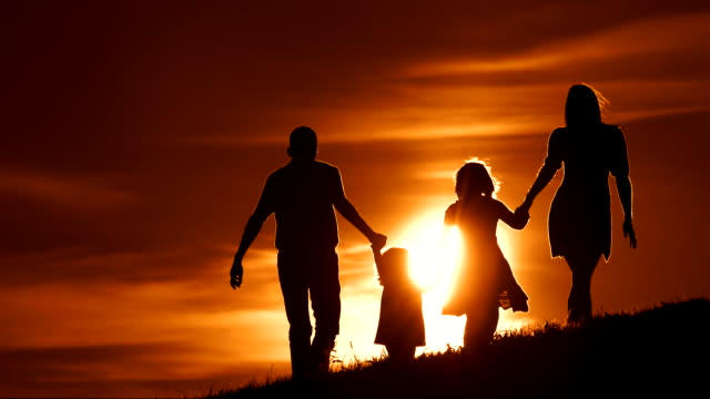 HD SLOW MOTION: Family Walking On A Meadow At Sunset video