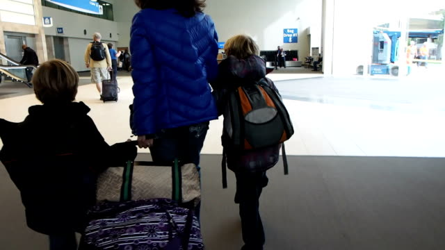 Family Walking Through Airport video