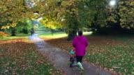 Family Walking Through Autumnal Park video