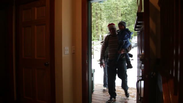 Family walks in from snow video