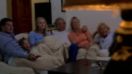 Family watching movie together video