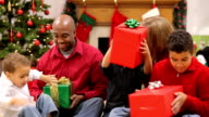 Family with Christmas presents video