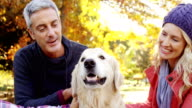 family with dog outdoors video