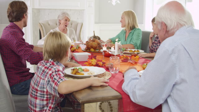 Family With Grandparents Enjoy Thanksgiving Meal Shot On R3D video