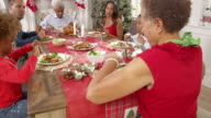 Family With Grandparents Enjoying Christmas Meal Shot On R3D video