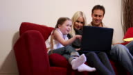DOLLY: Family with laptop video