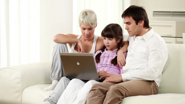 Family with laptop. video