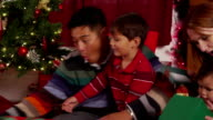 Family with presents on Christmas morning video