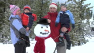 Family with snowman video