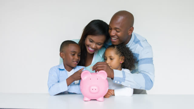 Family with their savings in a piggybank video