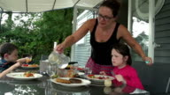 Family With Young Children Having An Outdoor Meal video