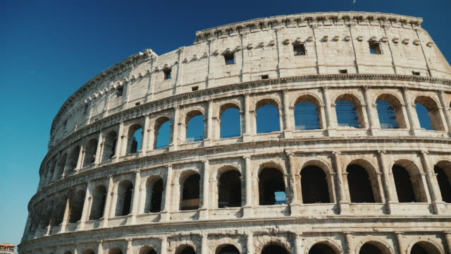 Famous coliseum in Rome, Italy. Low angle video, pan shot video