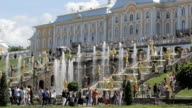 Famous Great Cascade at Peterhof park, show central stairs, many gold sculptures video