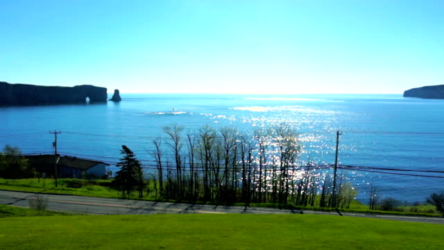 Famous Rocher Perce rock in Gaspe Peninsula, Quebec, Canada, Gaspesie region at blue sunrise and sparkling sun path with Bonaventure Island video