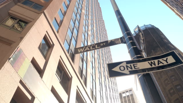 LOW ANGLE VIEW: Famous Wall Street sign in Manhattan New York financial district video