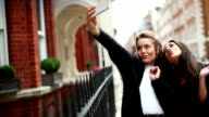 Fancy women in London selfie with mobile phone video