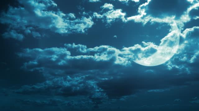 Fantastic sky background. Waxing moon behind the clouds. Timelapse. Loop. video