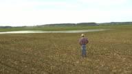 AERIAL Farmer checking irrigationequipment in field video