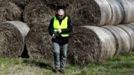 Farmer checking the hay bales video