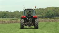 Farmer driving Tractor in field (Farm Agriculture) video