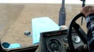 Farmer driving tractor video
