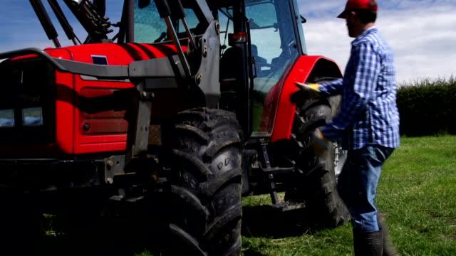 HD CRANE: Farmer getting into Tractor Cab (Farm Agriculture) video