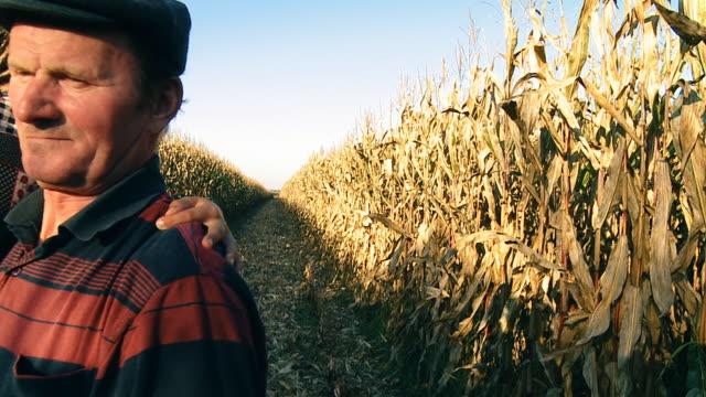HD SLOW MOTION: Farmer Holding Child In Corn Field video