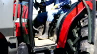 HD CRANE: Farmer in Tractor Smiling at Camera (Farm Agriculture) video