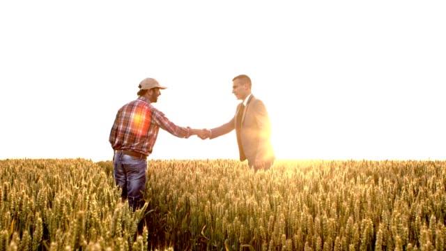 SLO MO Farmer make a deal with an executive video