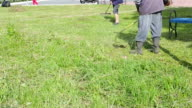 Farmer mow the lawn and clean the territory in the summer video