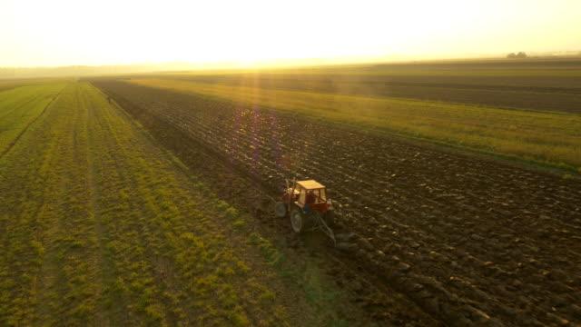 AERIAL Farmer Plowing The Field video