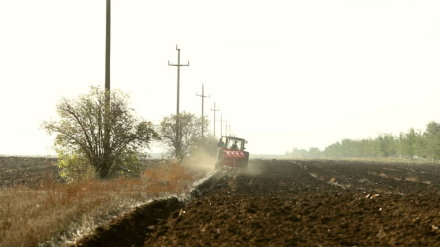 Farmer Plowing The Soil video