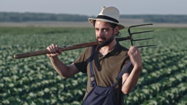 Farmer Posing with Pitchfork video