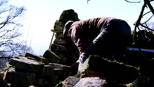 Farmer Repairing Old Stone Wall video