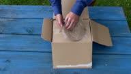 Farmer unpacking circular saw blade video