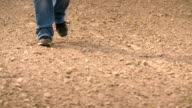 Farmer walks out onto his field and finds hard caked ground after a long dry winter. video